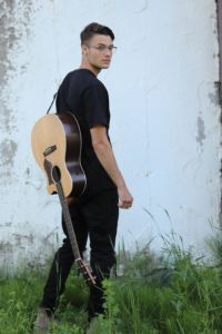Cameron Molloy with guitar on his back