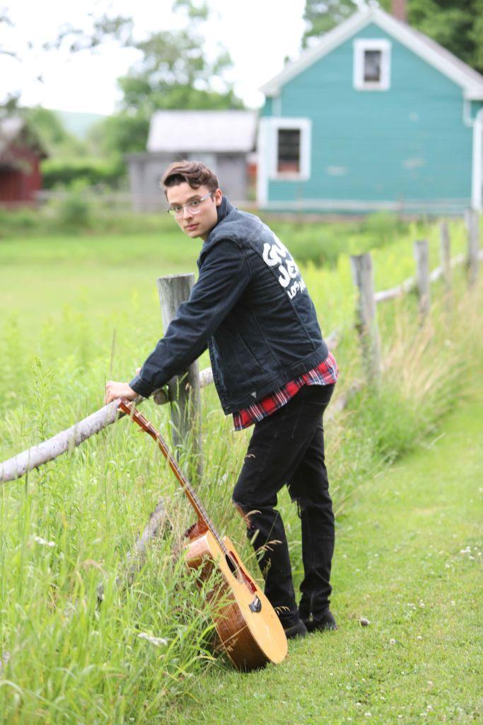 Cameron Molloy standing near fence