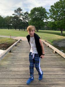 Walker Campbell standing on a bridge